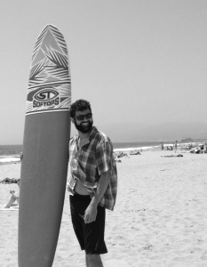 Jibran with surf board.
